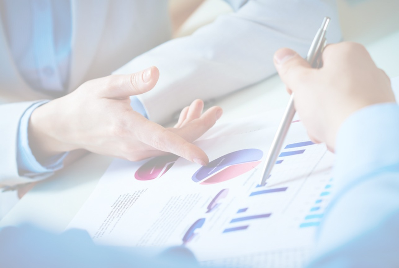 Hands Reviewing Charts - Services